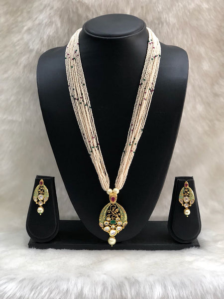 Green Multi-Layered Pearl Stranded Kundan Studded Necklace Set