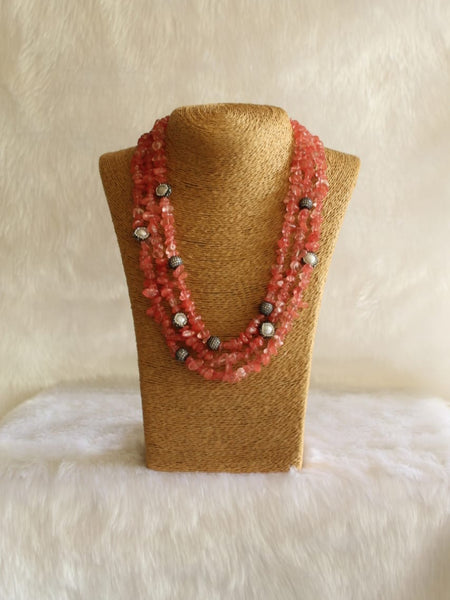 Three Stranded Pastel Red Gemstones And Crystal Necklace