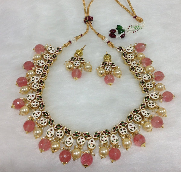 Ornamental Kundan and Pastel Red Necklace Set