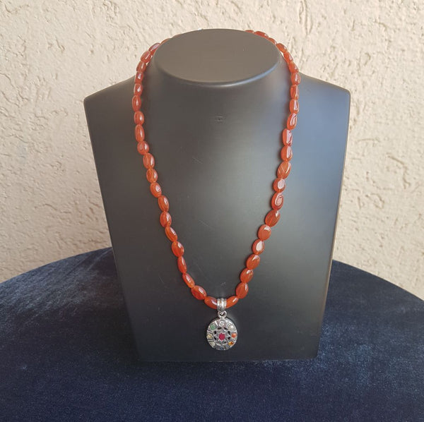 Fiery Orange Spherules in Silver Navratna Pendant Necklace