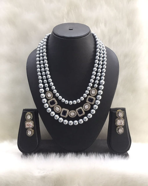 Three Stranded Shell Pearl Centric Gemstone Pedestal Necklace Set