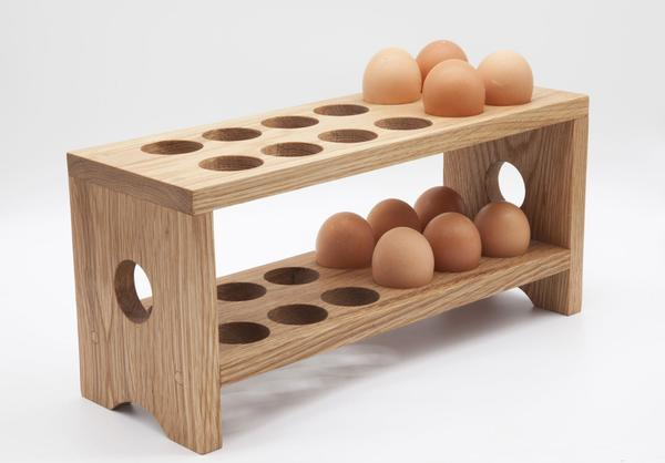 This is an egg tray made from solid wood holding 10 eggs. It can hold 24 eggs at its maximum capacity and is sealed with a polywax sealer for extra protection.