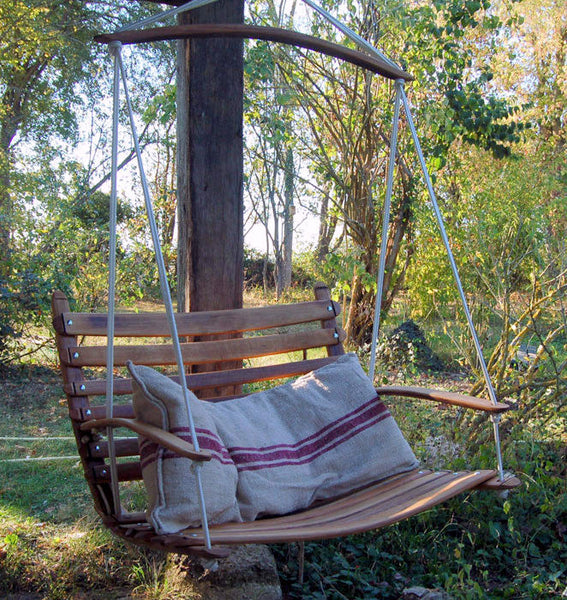 ilovani's range of outdoor swing chairs are perfectly designed for your patio or garden. This swing chair is hanging outside in the garden with white yachting rope.