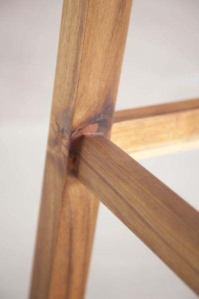 This is a close up of a bar stool detailing the solid blackwood design. The height of these breakfast and bar stools can be adjusted in the design.
