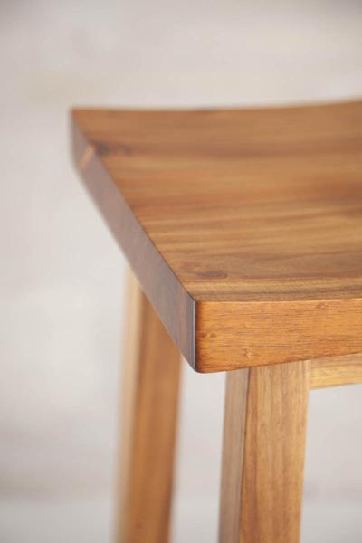 This is a close up of the table top of a bar stool. These bar stools are made from blackwood. The height can be customised to fit into most spaces.