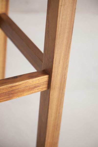 This is a close up of a bar stool leg made from blackwood. The height of these bar stools can be customised, so they can also be designed to be high bar chairs.