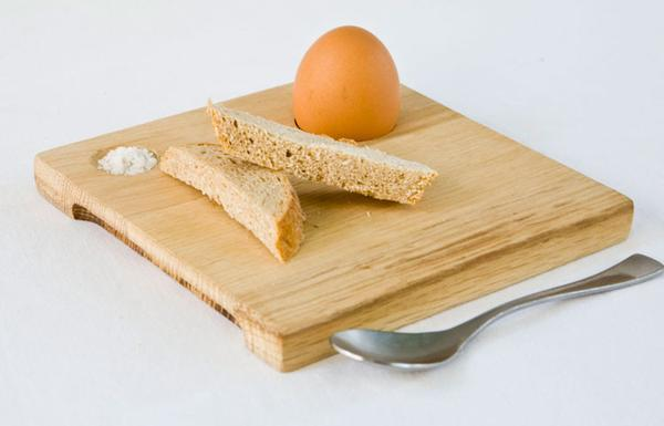 This is a wooden breakfast egg board made from reclaimed wood offcuts. These boards are hand finished. This board has a space for salt, one egg and a some bread.
