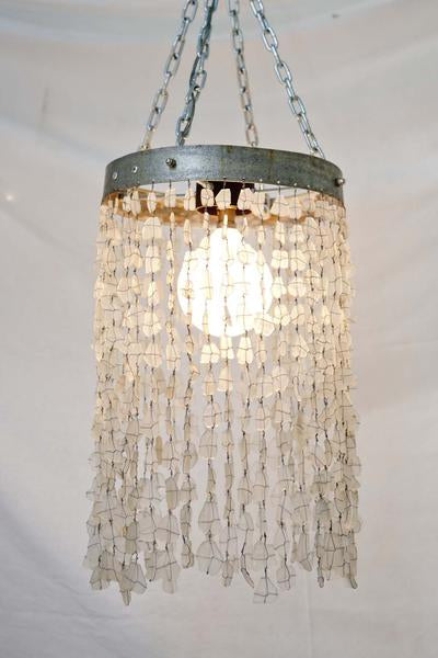 This is a chandelier made with 500 glass beads, and the hoop is made from galvanised steel from an old wine barrel.