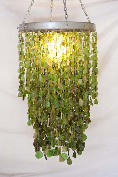 This is a recycled glass chandelier made from and galvanised wine barrel steel made. It has 3 rings and 3000 glass beads.