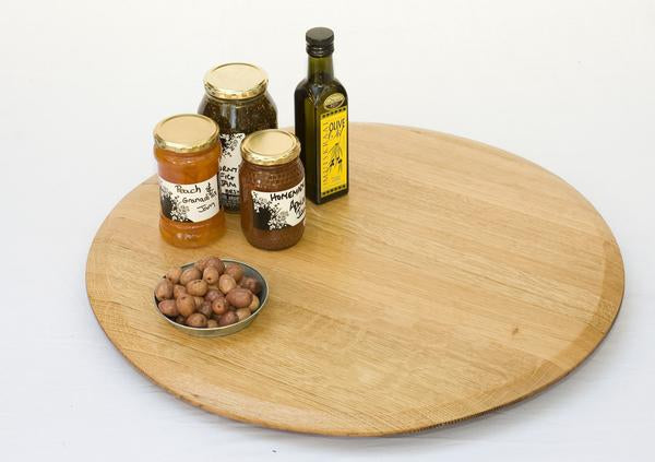 This is a lazy susan with condiments. This wooden turntable is made from recycled oak barrels.