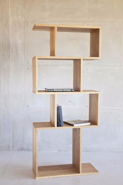 This is one of our modern shelves made from oak and sealed with wax, or natural white oil. It has 4 cubes, stacked vertically. Ideal for stacking coffee table books.