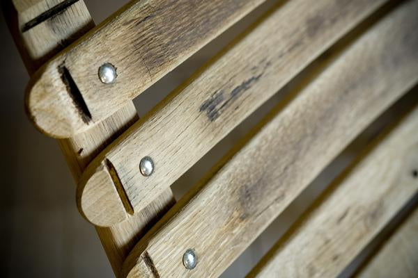This is a close up of the reclining back of the loveseat, made from oak barrels.