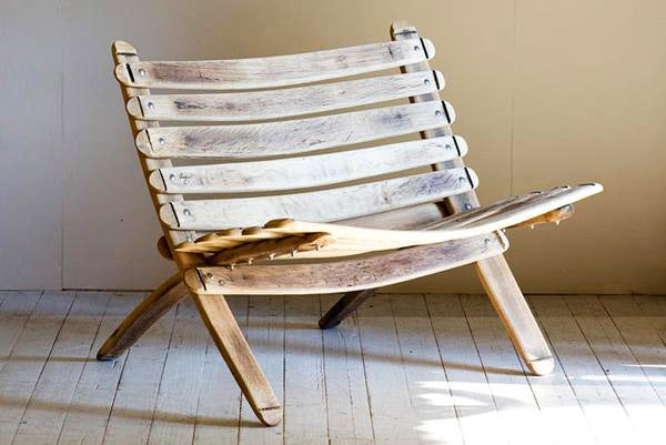 This is a loveseat, made from reclaimed oak barrels.