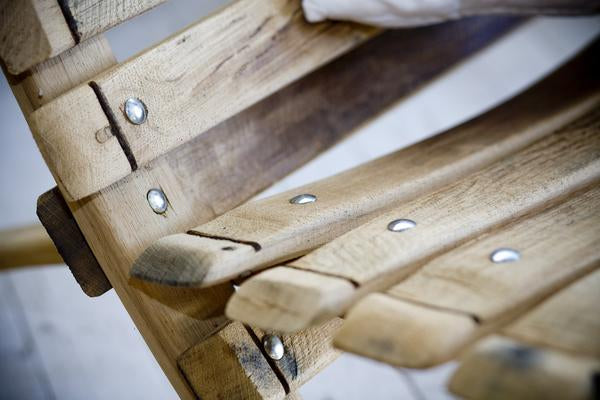 This is a close up of the reclining loveseat, detailing the reclaimed oak barrel staves.