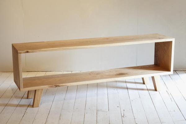 This is a rectangular oak wood tv table stand.