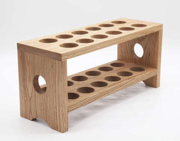This is a wooden egg carton, or tray made from solid wood. It can hold a maximum of 24 eggs.
