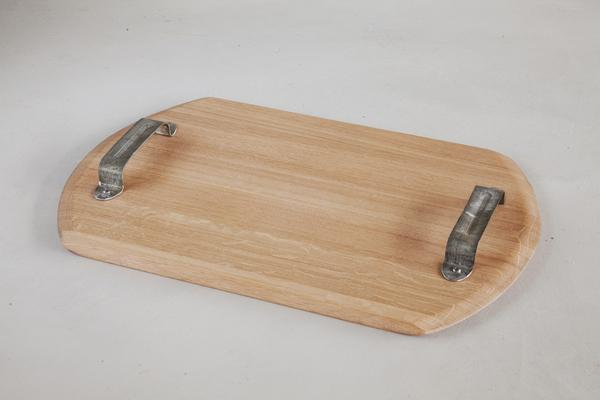 This is a wooden serving tray made from oak barrels. It has metal handles made from galvanised steel.