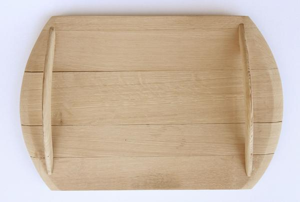This is a wooden serving tray made from oak barrels. It has wooden handles.