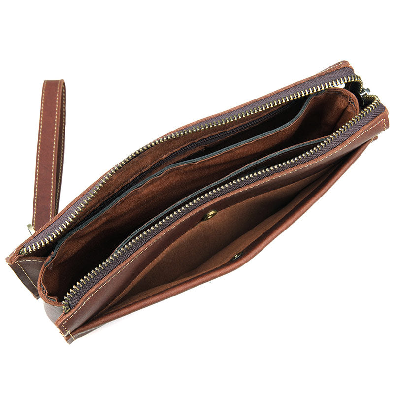 Modern Vintage Leather Clutch Bag With Wrist Strap