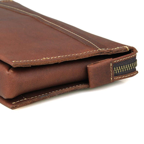 Image of Modern Vintage Leather Clutch Bag With Wrist Strap-Universal Store London™