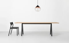 Minimalist dining table made of oak and ash