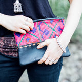 Hand stitched leather Clutch with old indian embroidery.