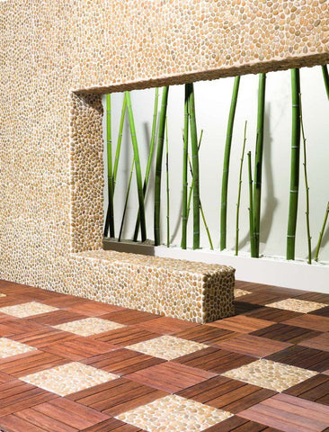 Amber pebble tile patio pavers with wood deck tiles from Beyond Tile