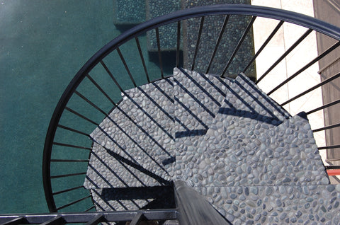 Outdoor steps in black pebble tile from Beyond Tile