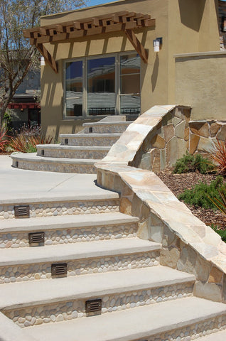 Outdoor patio entrance in tan pebble tile from Beyond Tile
