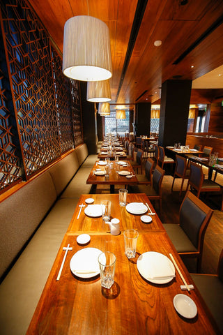 Reclaimed teak flooring for the ceiling and reclaimed teak table tops Matsuhisa, Denver Co