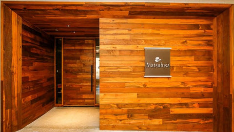 Beyond Tile's Teak flooring as panels for the entrance from for Matsuhisa Denver, Co