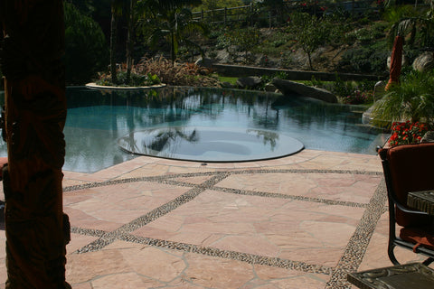 Melange pebble tile for striking pool deck accent from Beyond Tile