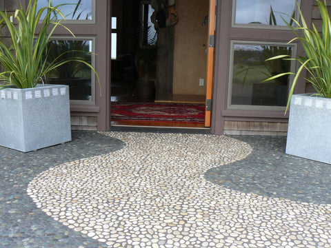 Outdoor entrance in white pebble tuile and river rock pebble tile from Beyond Tile