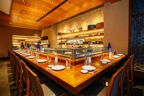 Sushi Bar feature 29 foot reclaimed teak bar top, Matsuhisa Denver