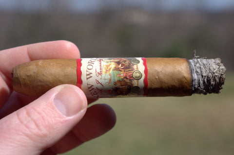 Image of a lit AJ Fernandez New World Connecticut Belicoso cigar