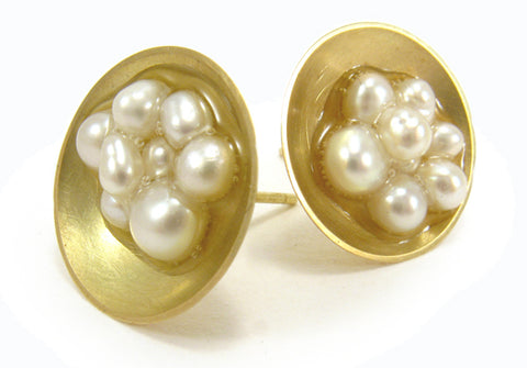 Caviar sterling silver stud earrings with freshwater pearls in resin.