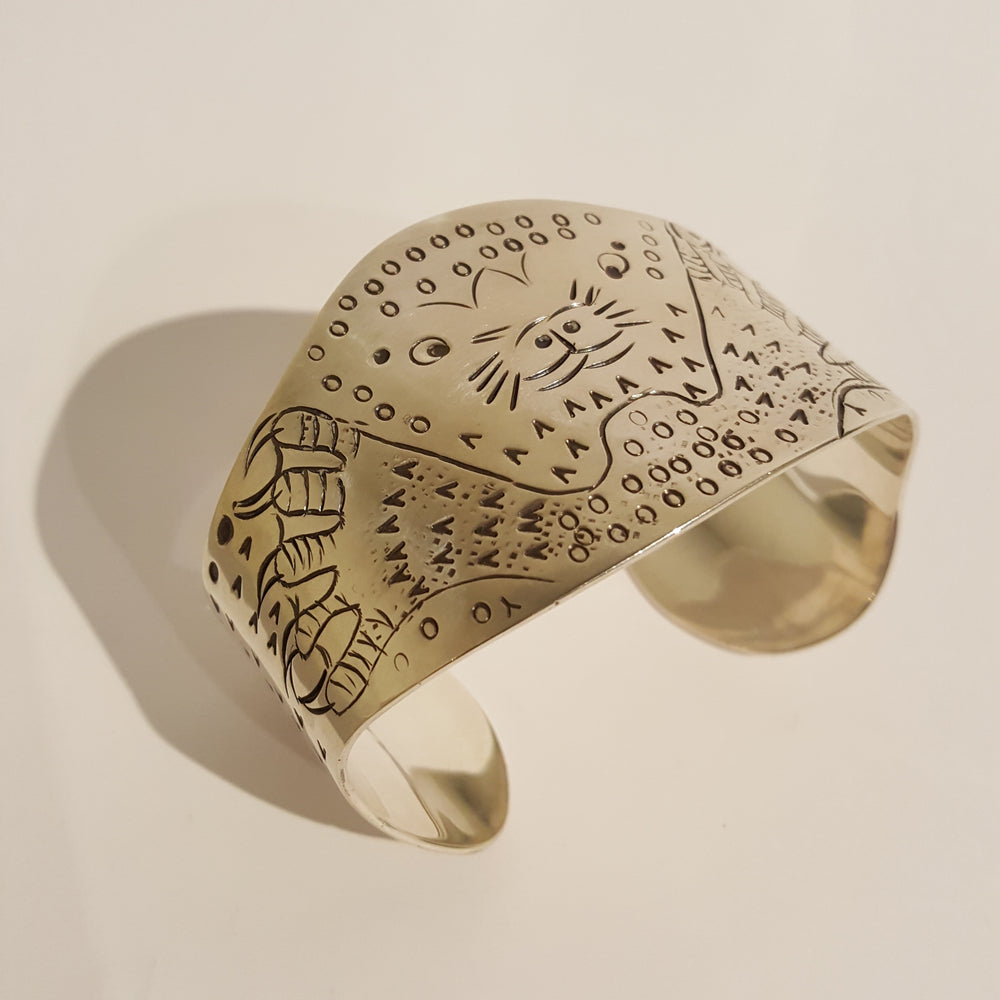 Seal hunting cod cuff bracelet in sterling silver by Jonas Audlakiak.