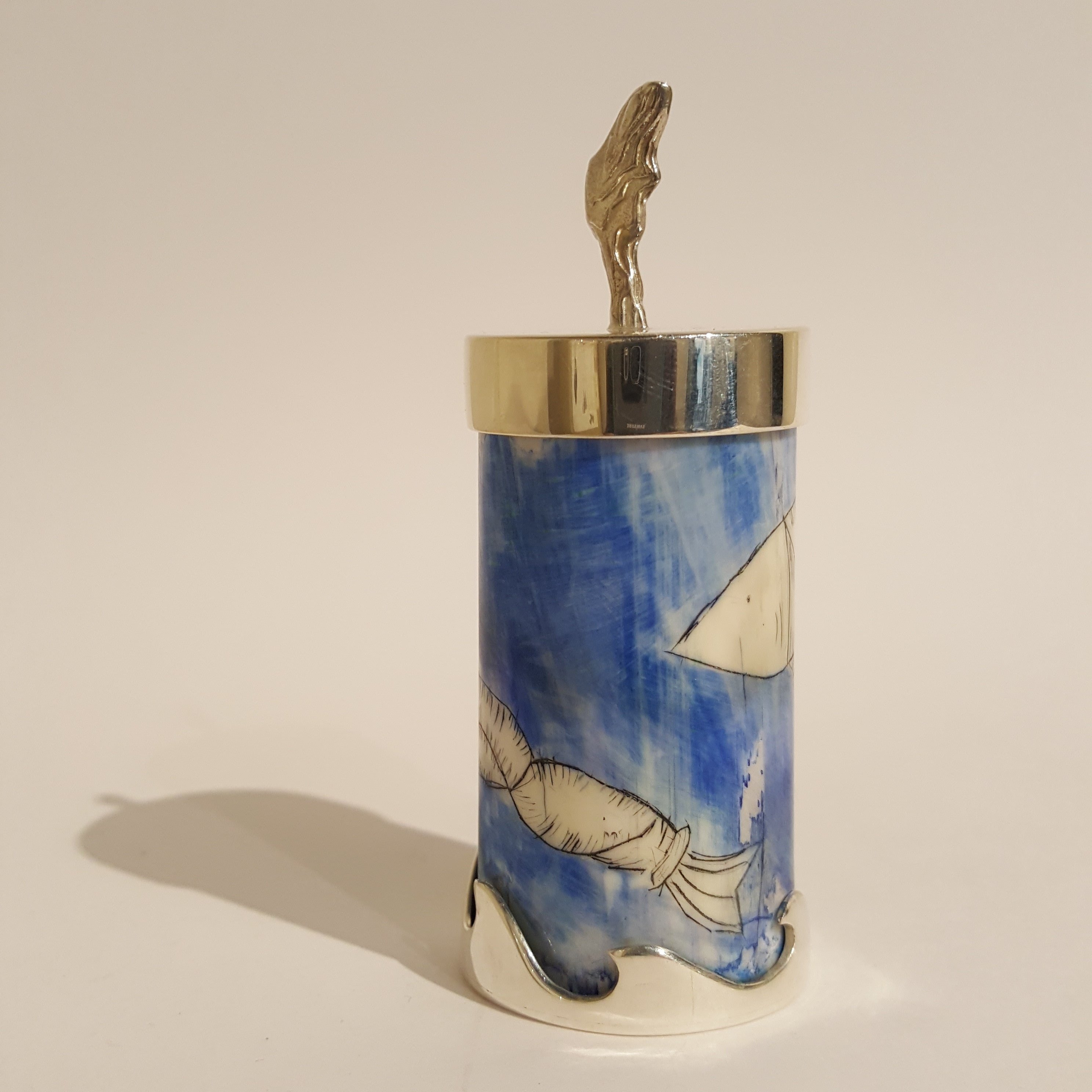 Fishtail container in walrus tusk ivory, and sterling silver by Anne Qammaniq-Hellwig.