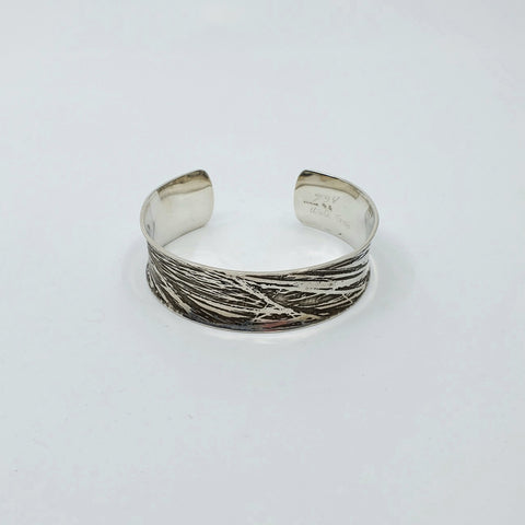 Silver cuff by Andrew Goss for L A Pai gallery