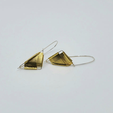 Gold colour earrings by Andrew Goss for La Pai gallery