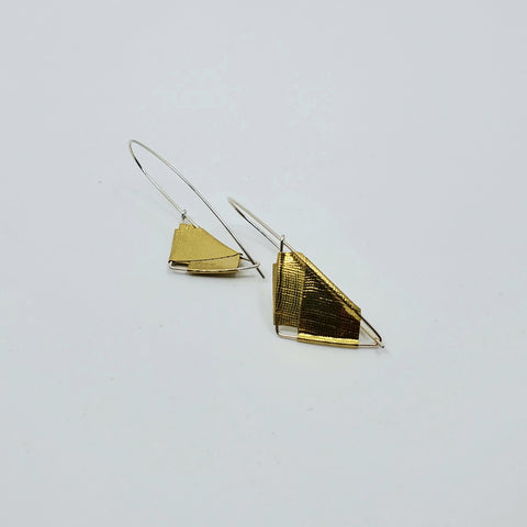Front and back of brass sail earrings for La Pai gallery