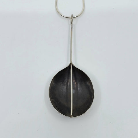 Back of silver pendant by Andrew Goss for La Pai gallery