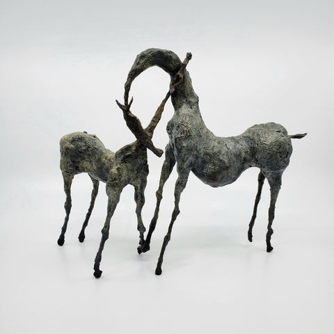 Bini, bronze sculpture of a pair of horses with necks stretched toward each other. From a series of 8; 27 x 21 x 11 cm.