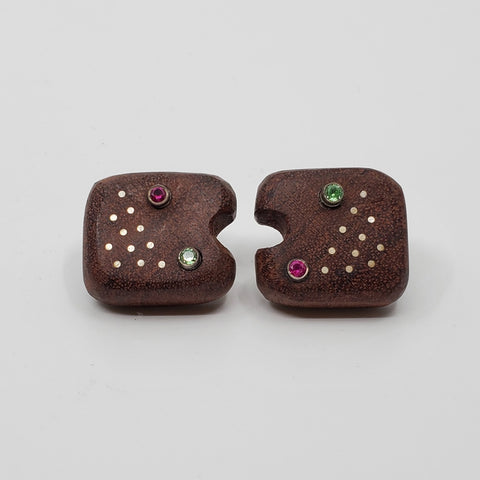 Omnom stud earrings of hand-carved rosewood inlaid with sterling silver and set with bright multi- colored synthetic stones. 2.5 x 2 x 1 cm