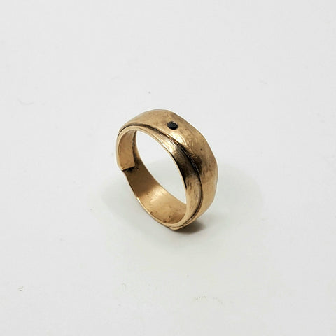 Hammered ribbon ring is a fine and delicate 12k gold ring with rugged texturing and a black diamond detail. Size 8.75