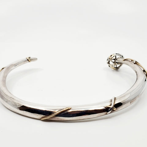This statement collar is hollow formed in sterling silver, 14k and 18k gold. 12 x 13 x 2 cm