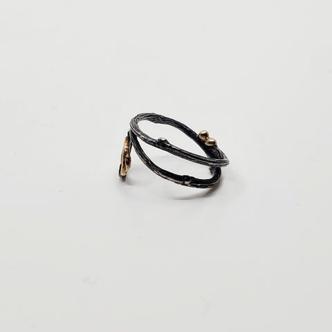 Spiral Ring in oxidized sterling silver with recycled 12k gold details. Size 5.5  side view