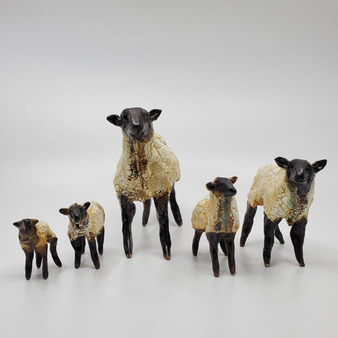 White and Brown Sheep. small ceramic sculptures. Erin is well-known for her mysterious glaze combination for the sheep's fleece.  1. Largest, 12 x 18 x6 cm, $250; 2. medium-large, 9x13x5 cm, $200; 3. Medium, 7x10x3cm, $125; 4. Small, 5x7x3cm, $100; 5. Baby,  4x5x2cm, $75.