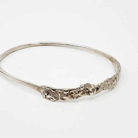 Bangle bracelet from the Forerunner series in a large/ extra large size in sterling silver.