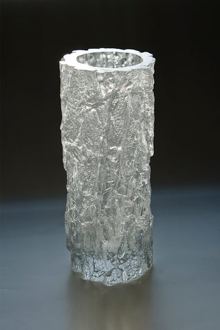 Oak Log Vessel Number 2485, cast crystal, 27 x 10.5 cm.  Satisfyingly heavy, this cast crystal oak vessel functions as a brilliantly reflective vase.